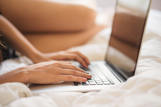 Typing on the laptop in bed